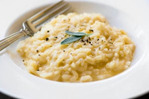 Instant Pot Cheddar Risotto with fresh sage leaves