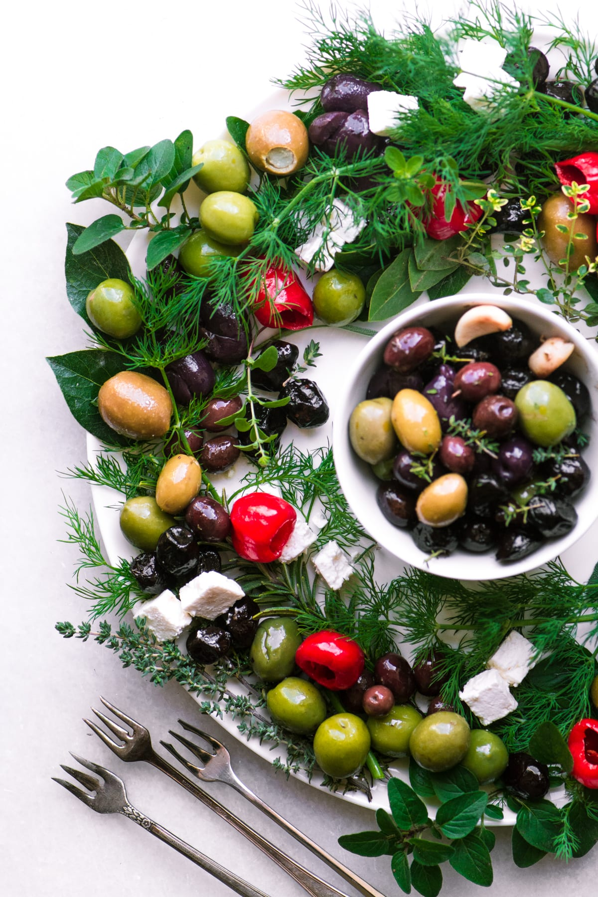 Festive olive and herb wreath appetizer with forks