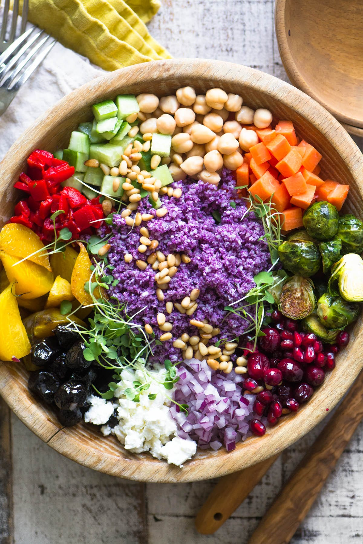 Colorful Purple Cauliflower Rice Salad in a wooden bowl