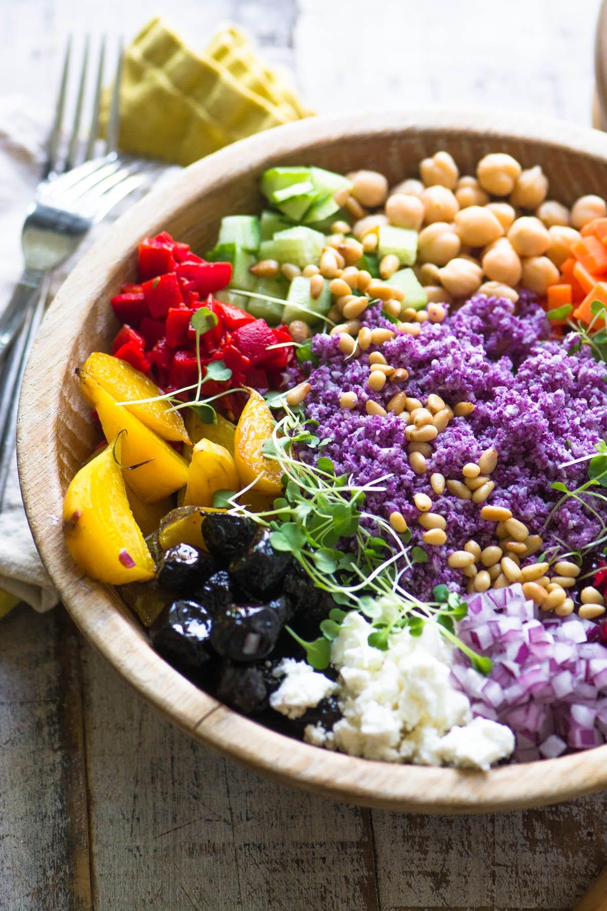purple cauliflower rice salad in a wooden bowl