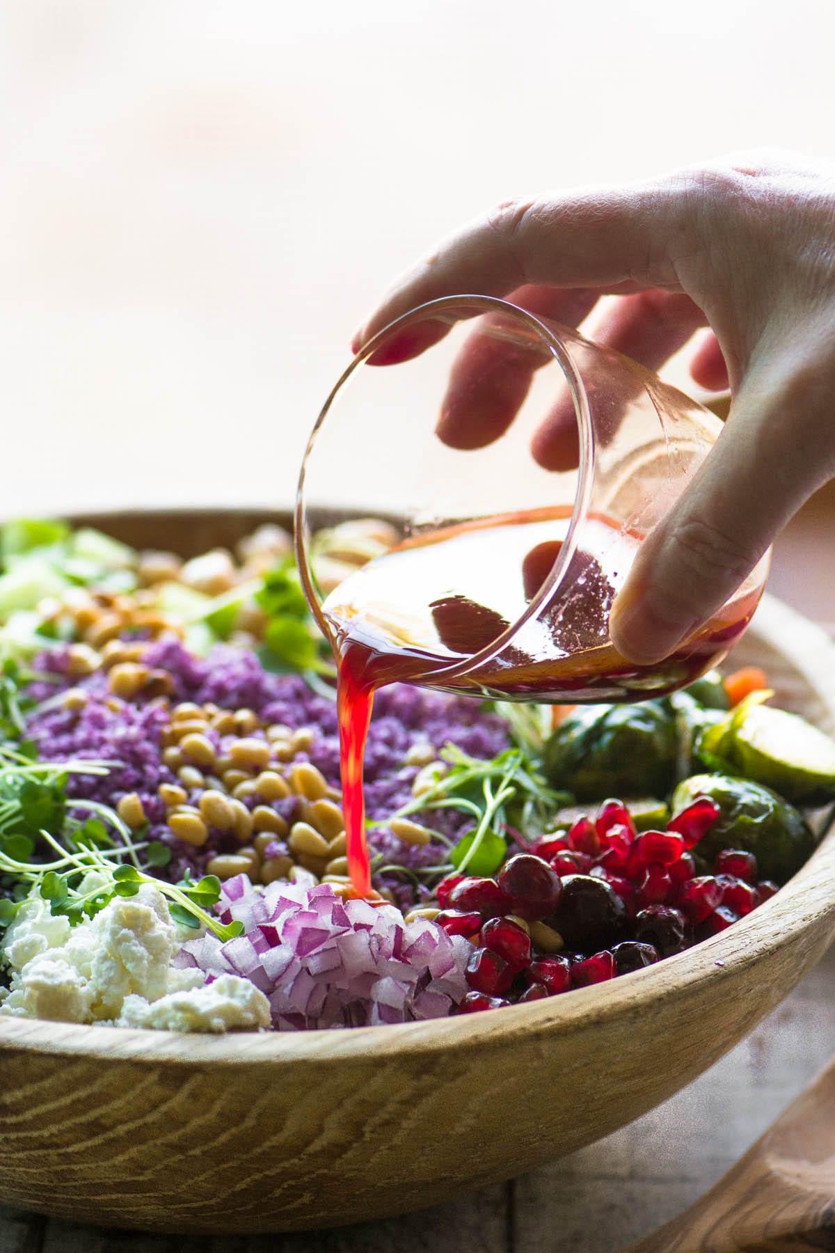 Dressing a purple cauliflower rice salad