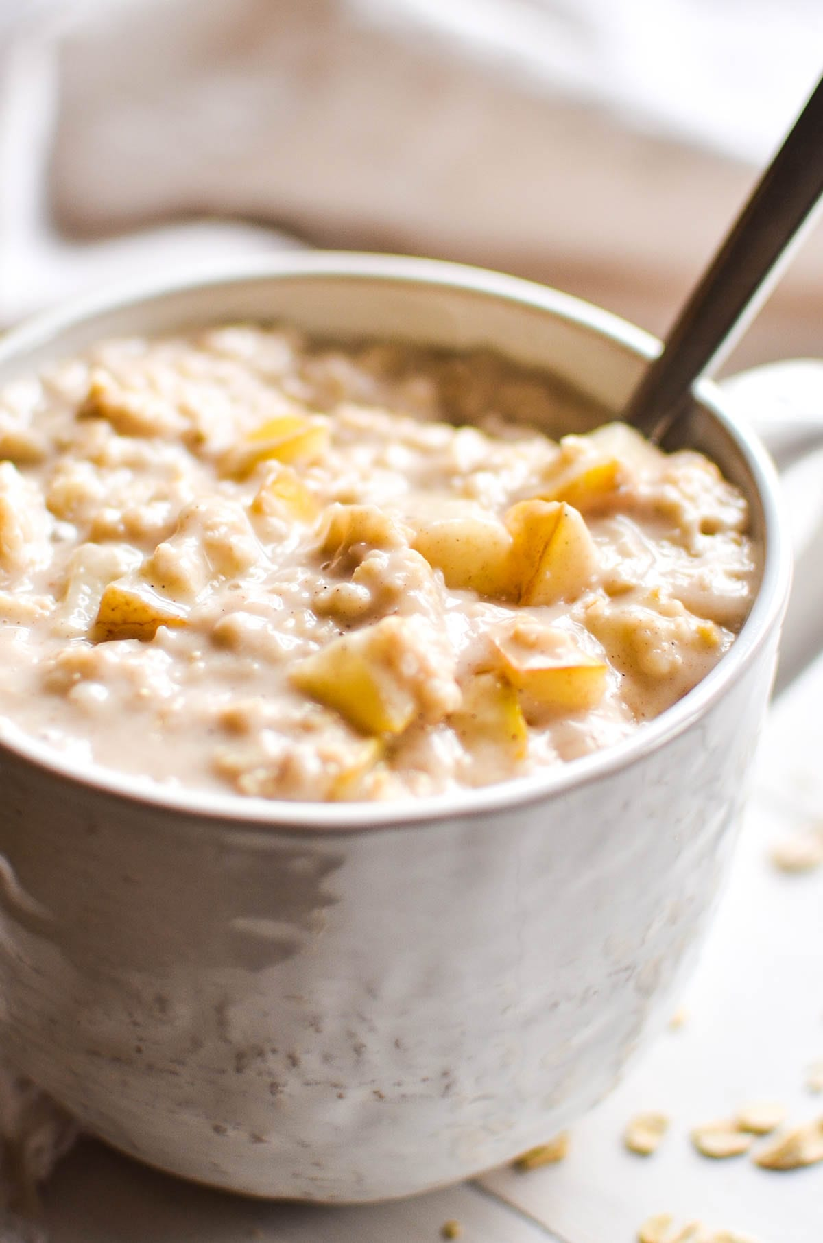 Vanilla spiced pear oatmeal with spoon