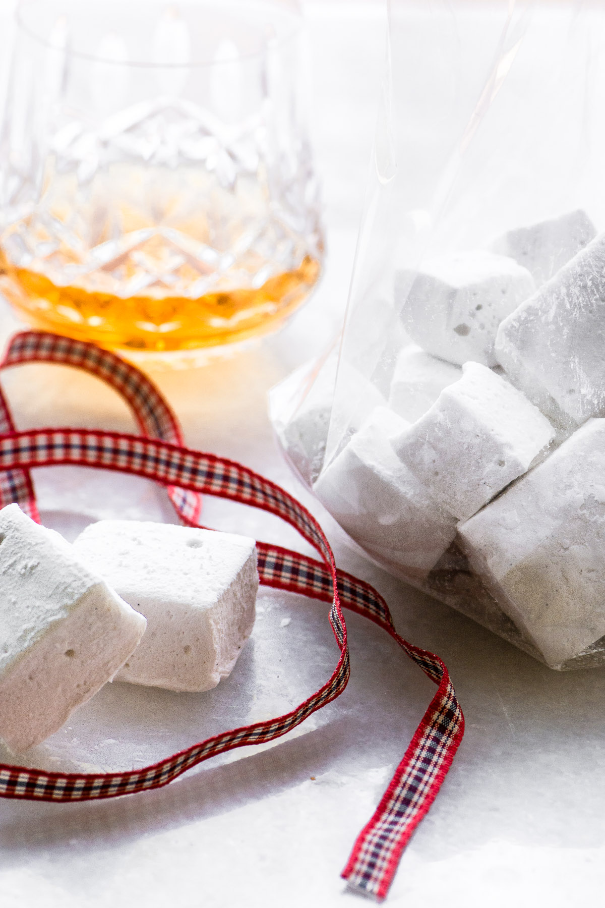 Homemade Bourbon Marshmallows with a glass of bourbon