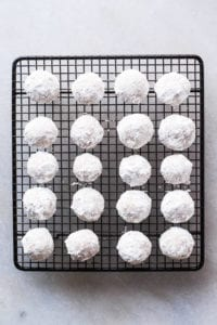 Toasted Almond Russian Tea Cakes on a cooling rack