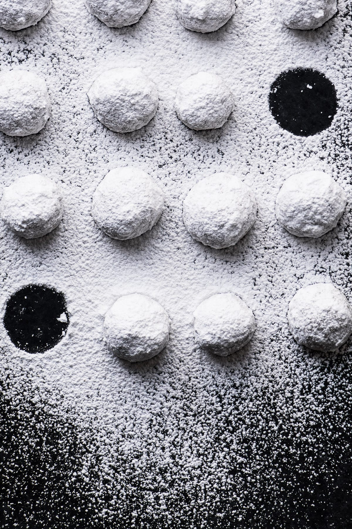 toasted almond Russian tea cake cookies covered with powdered sugar