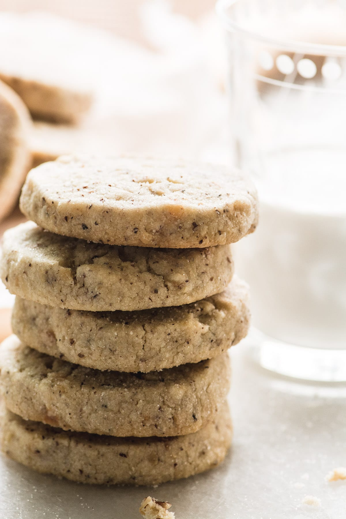 A stack of hazelnut sandies cookies with milk