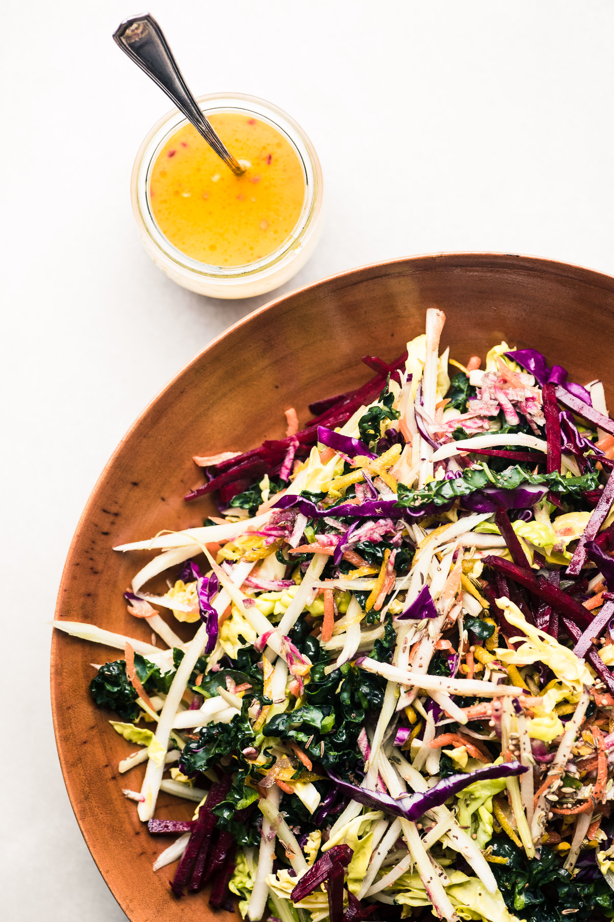 Vibrant Winter Slaw in a wooden bowl with citrus vinaigrette