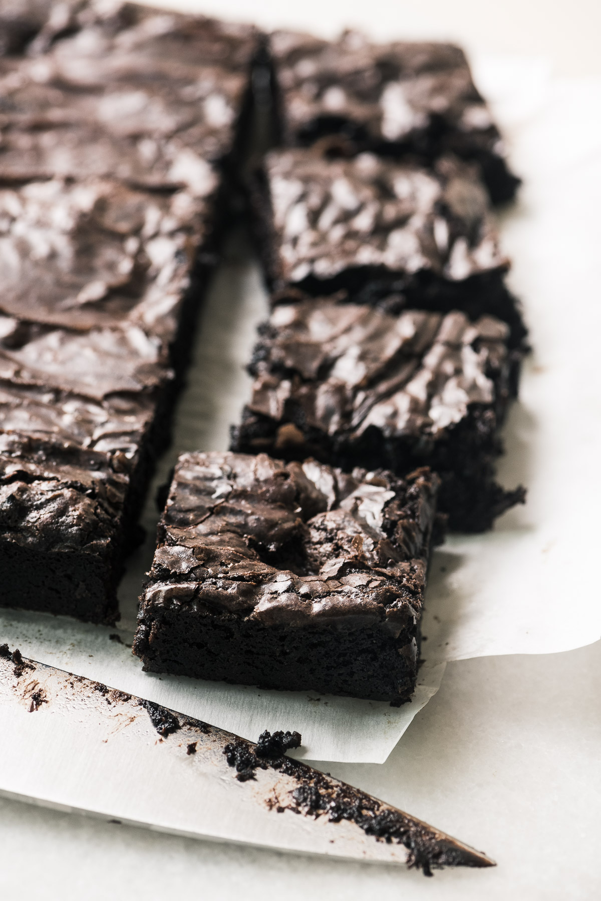 I Want to Marry You Brownies sliced, with a knife