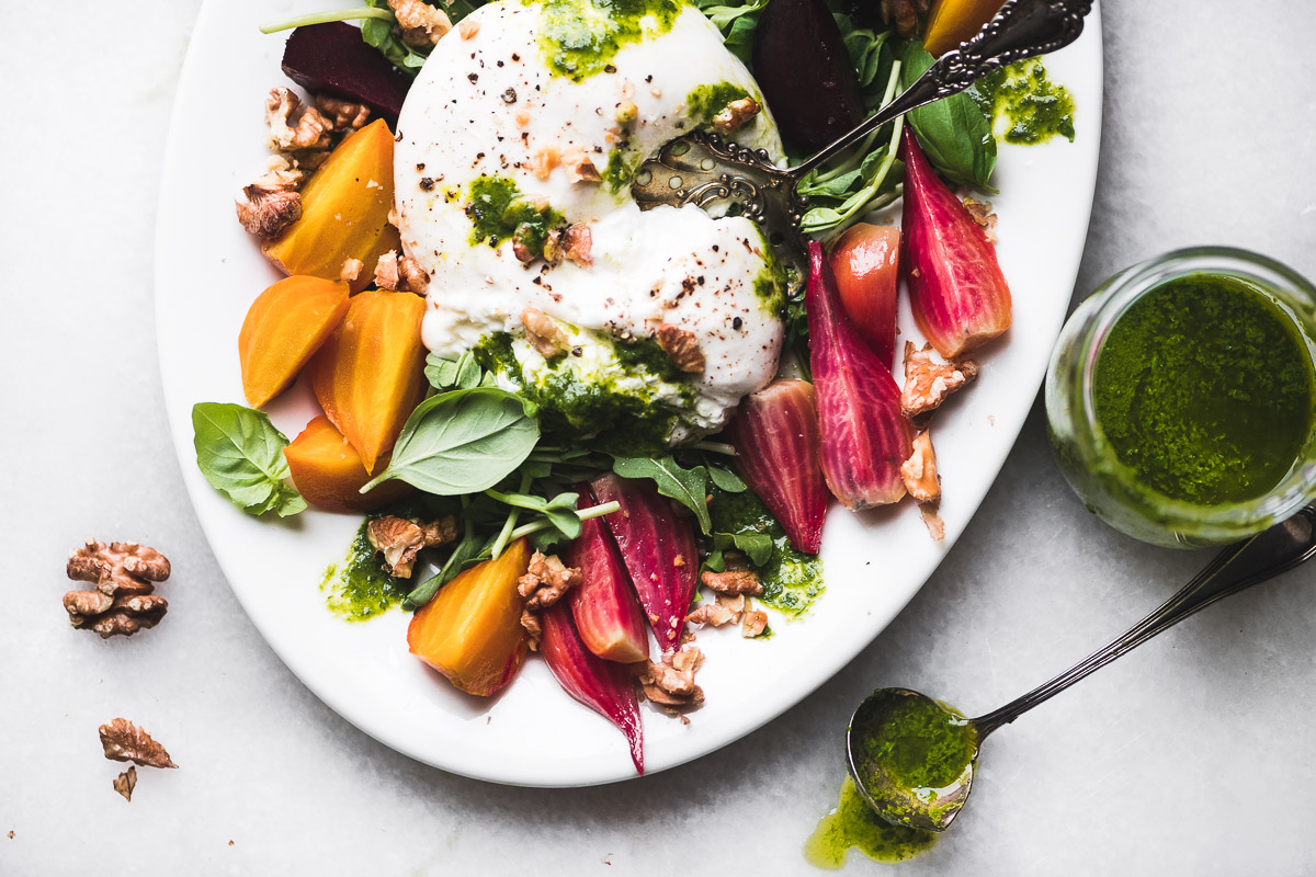 Roasted Beets and burrata on a white platter