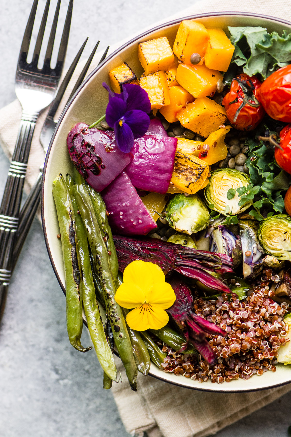 A roasted vegetable winter bliss bowl with forks