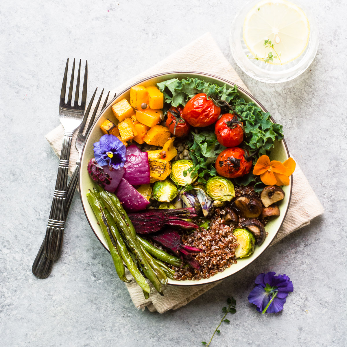 A roasted veggie winter bliss bowl with fork