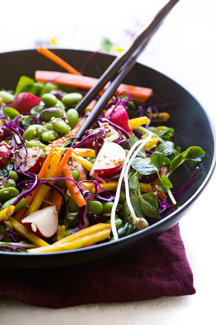 a colorful and healthy edamame salad in a black bowl