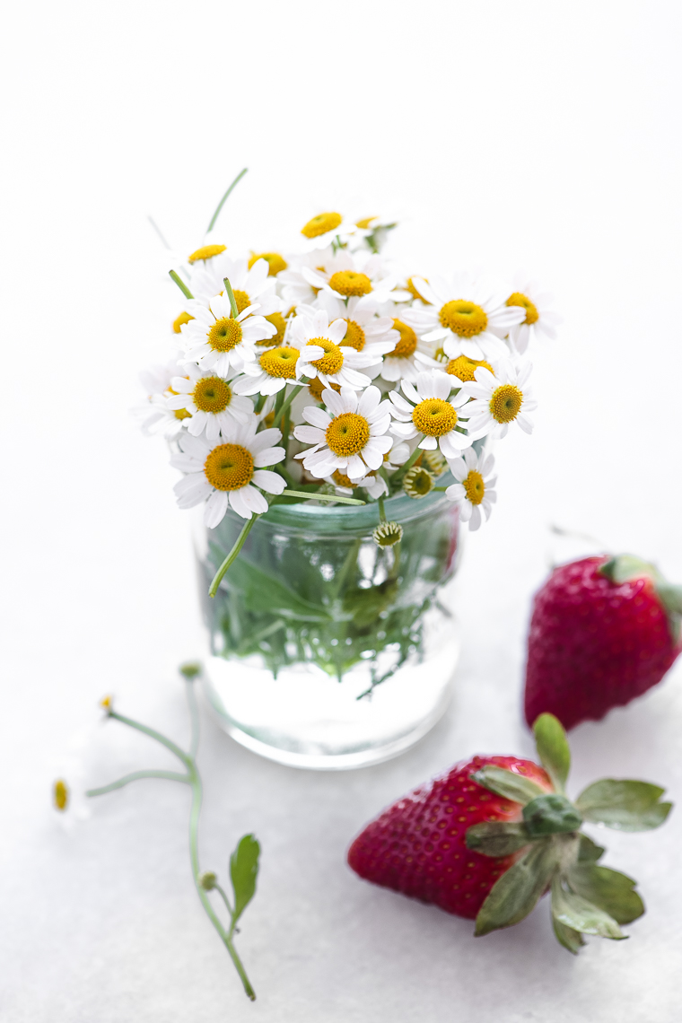 chamomile flowers in a small glass jar