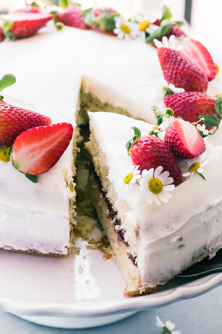 strawberry cake topped with strawberries