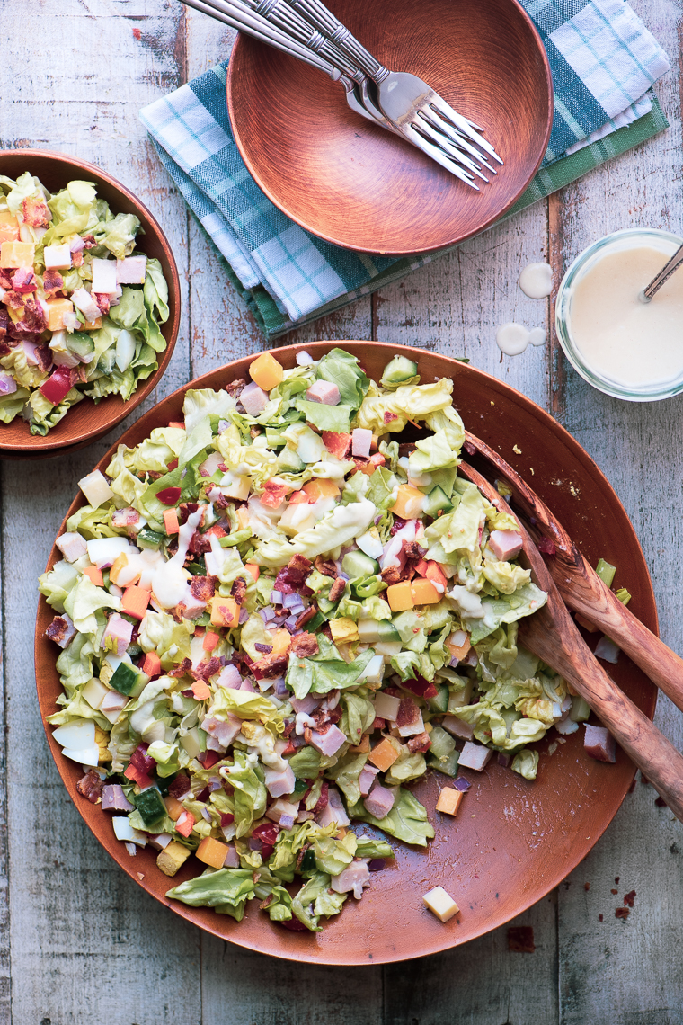 chopped chef salad in a wooden salad bowl