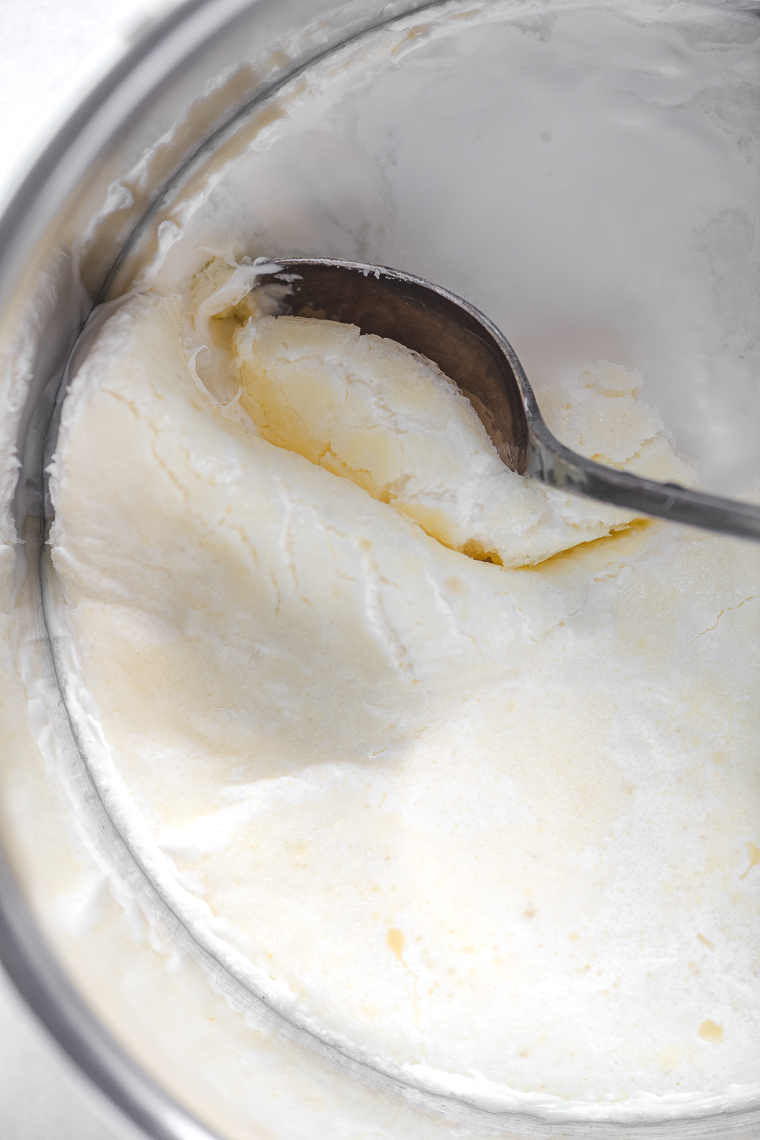 scooping clotted cream from Instant Pot