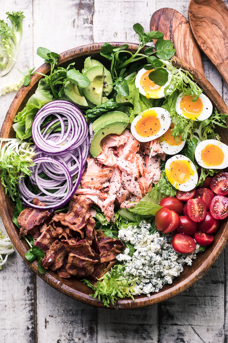 Salmon Cobb Salad in a wooden salad bowl