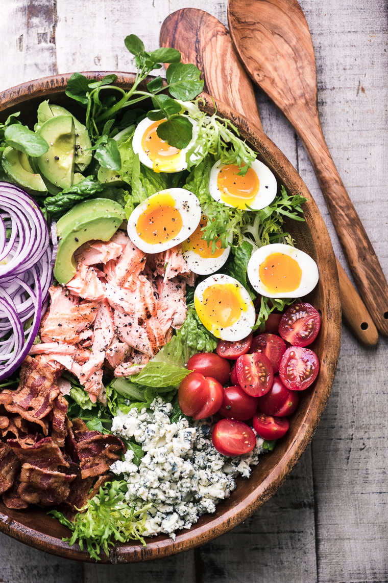 Salmon Cobb Salad in a wooden bowl
