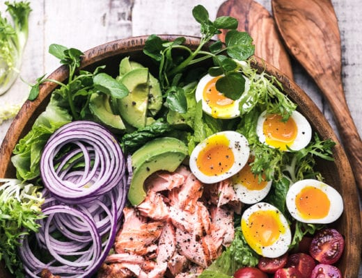 Salmon Cobb Salad in a wooden salad bowl with salad spoons