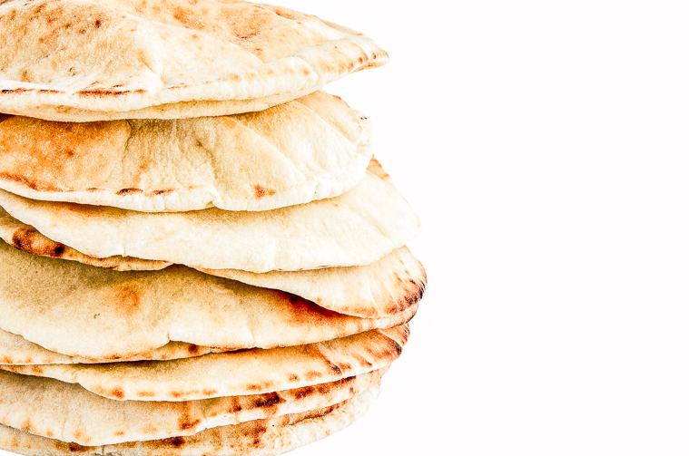 a stack of homemade pita bread