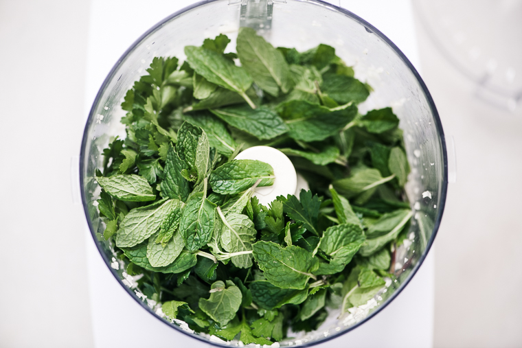 parsley and mint in a processor for Balela salad