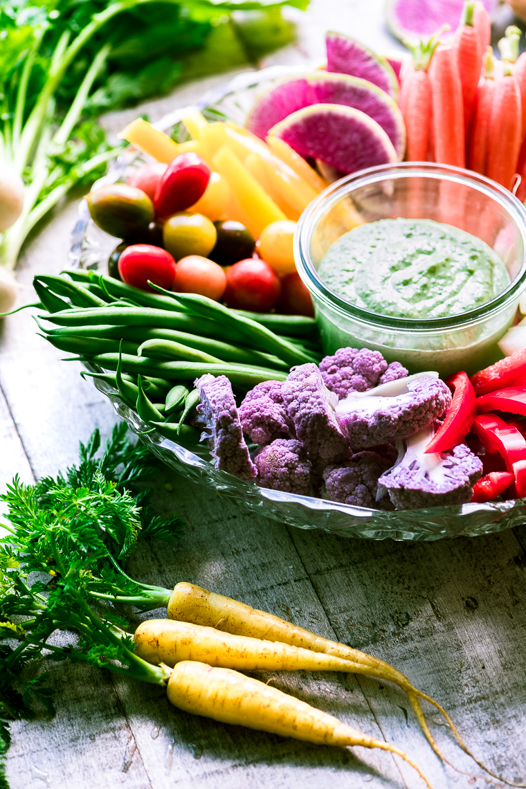 spring crudité veggies on a plate with dip
