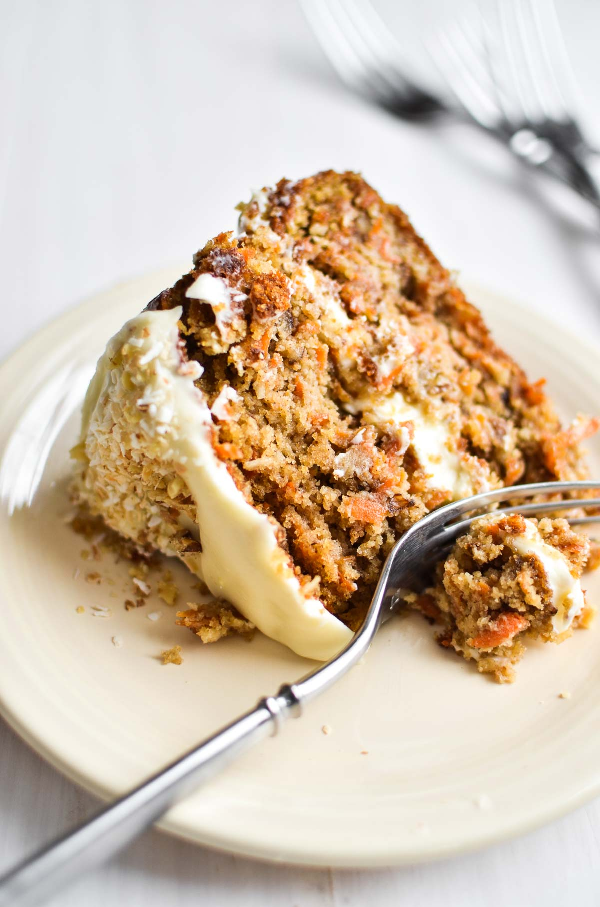 A slice of Gluten Free Carrot Cake with Cream Cheese Frosting
