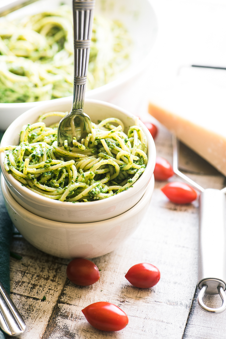Pasta with Chive Parsley Pesto in a white bowl