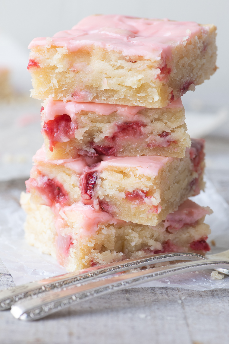 a stack of strawberry lemon blondies