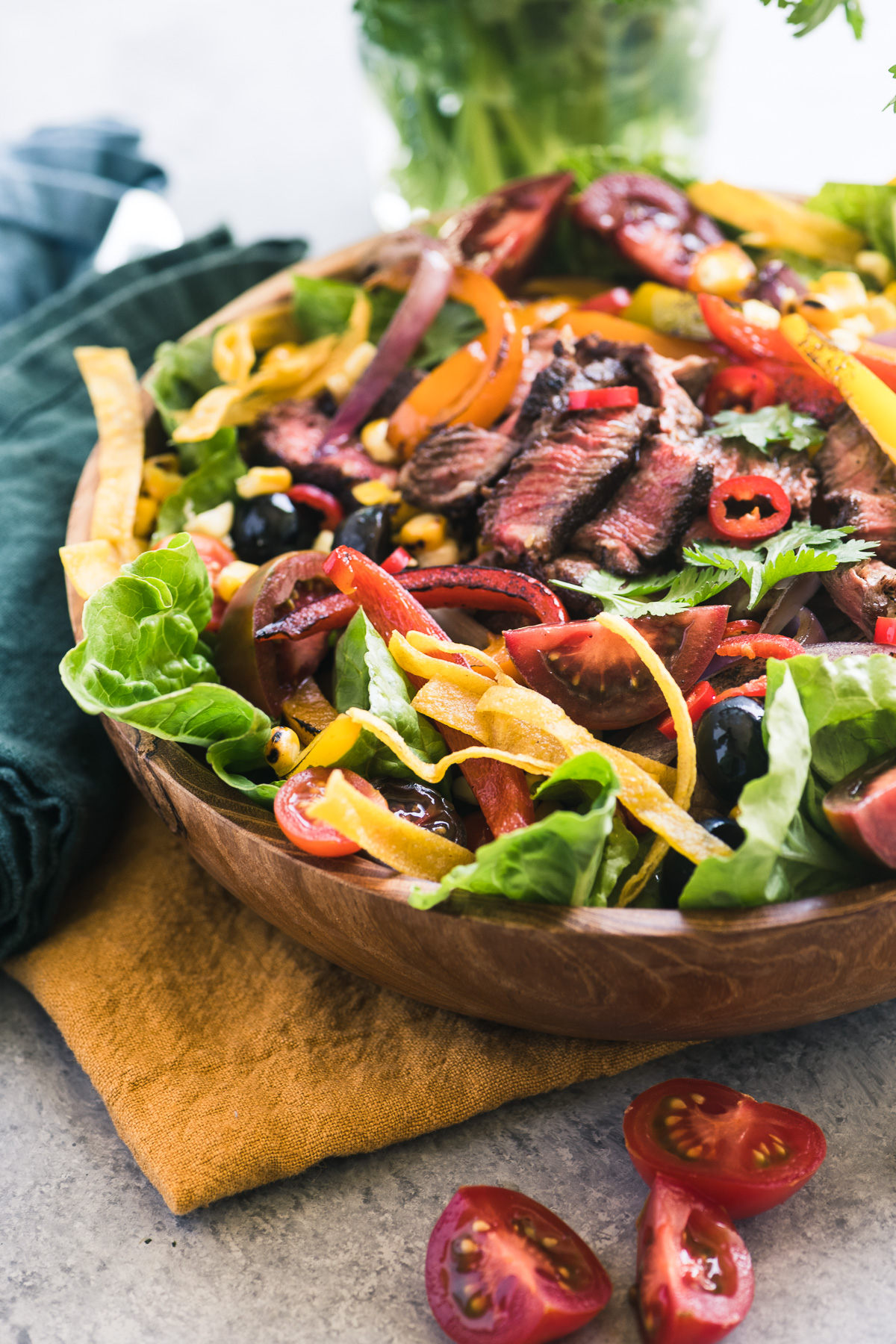 Mexican Fajita Steak Salad in a wooden bowl