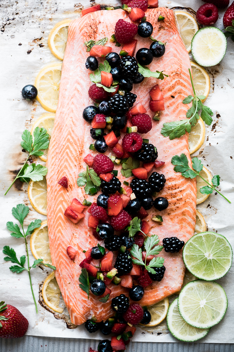 Roasted Salmon with Berry Salsa on parchment paper
