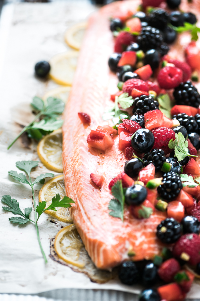 a whole side of salmon topped with mixed berry salsa