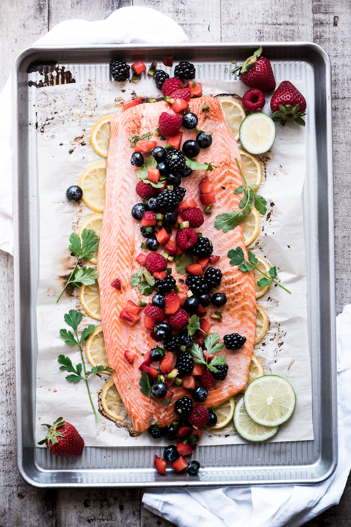 Salmon with berry salsa on a sheet pan