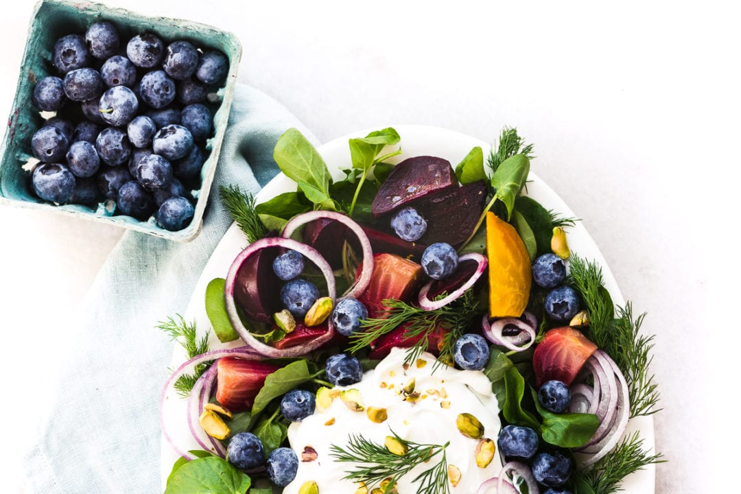Beet and blueberry salad with a box of blueberries