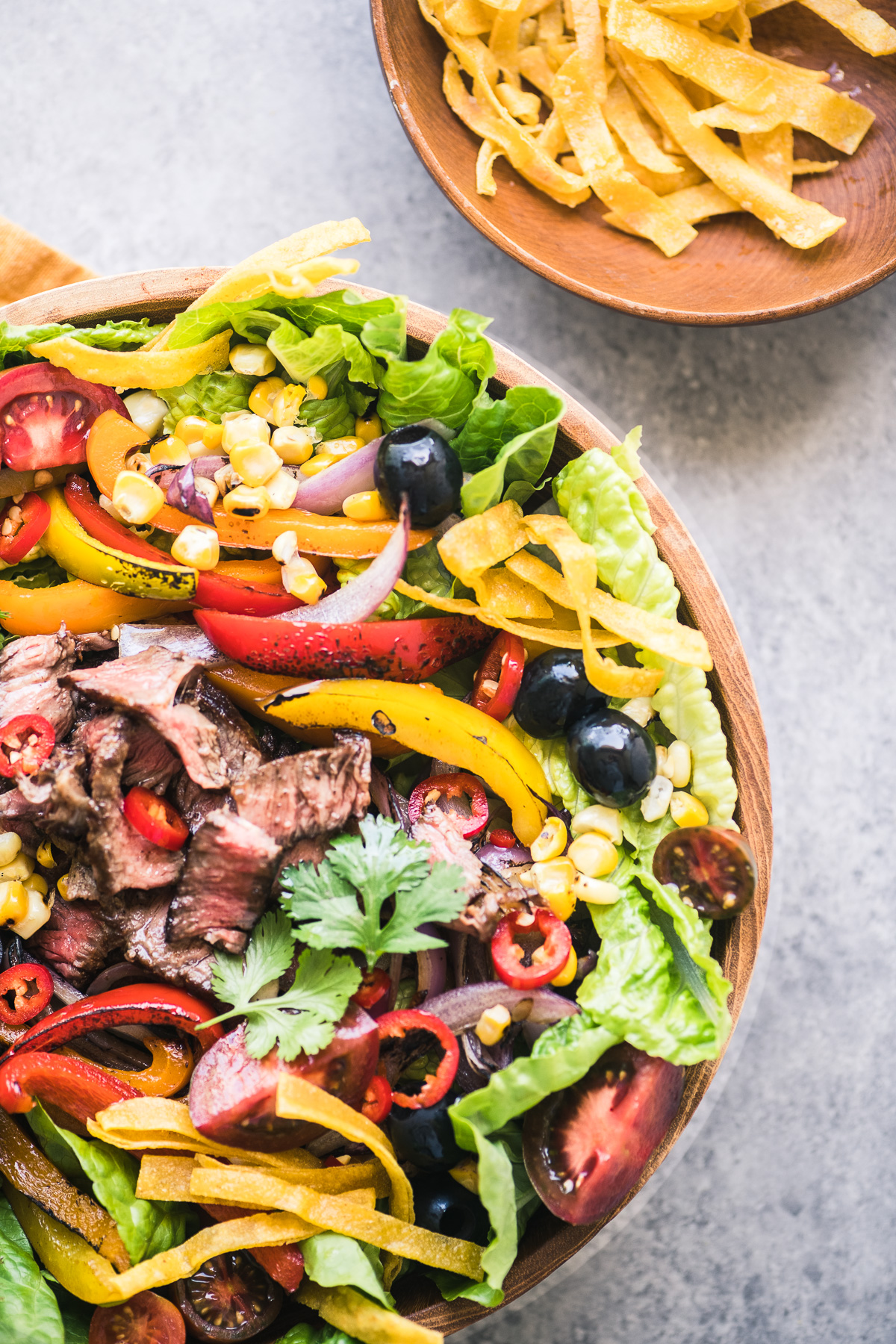 Tex-Mex fajita steak salad with homemade tortilla strips
