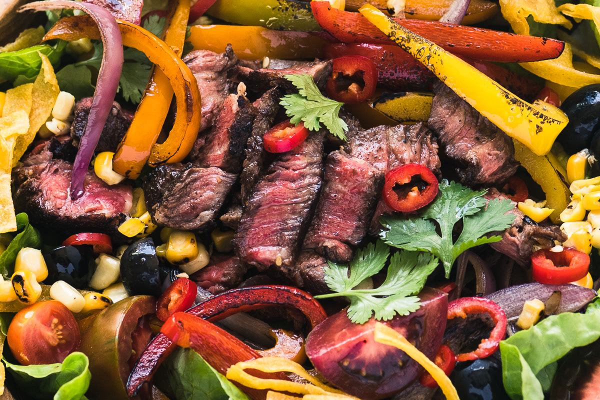 steak fajita salad with colorful peppers
