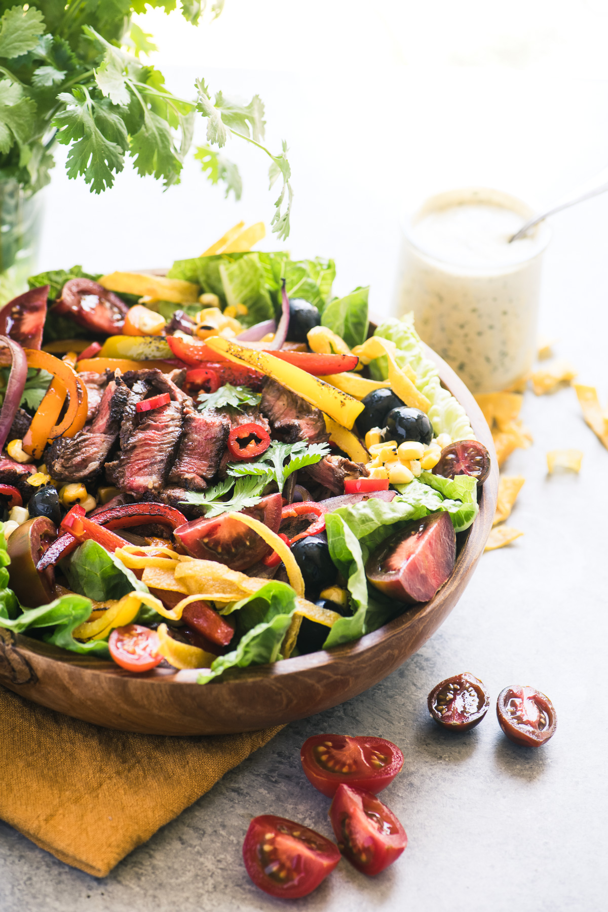 Mexican Steak Fajita Salad with dressing and cilantro