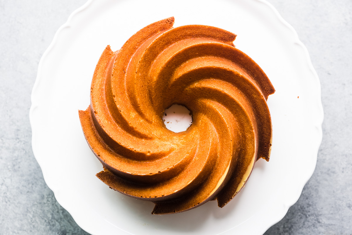 Orange Blossom Bundt Cake on a white platter