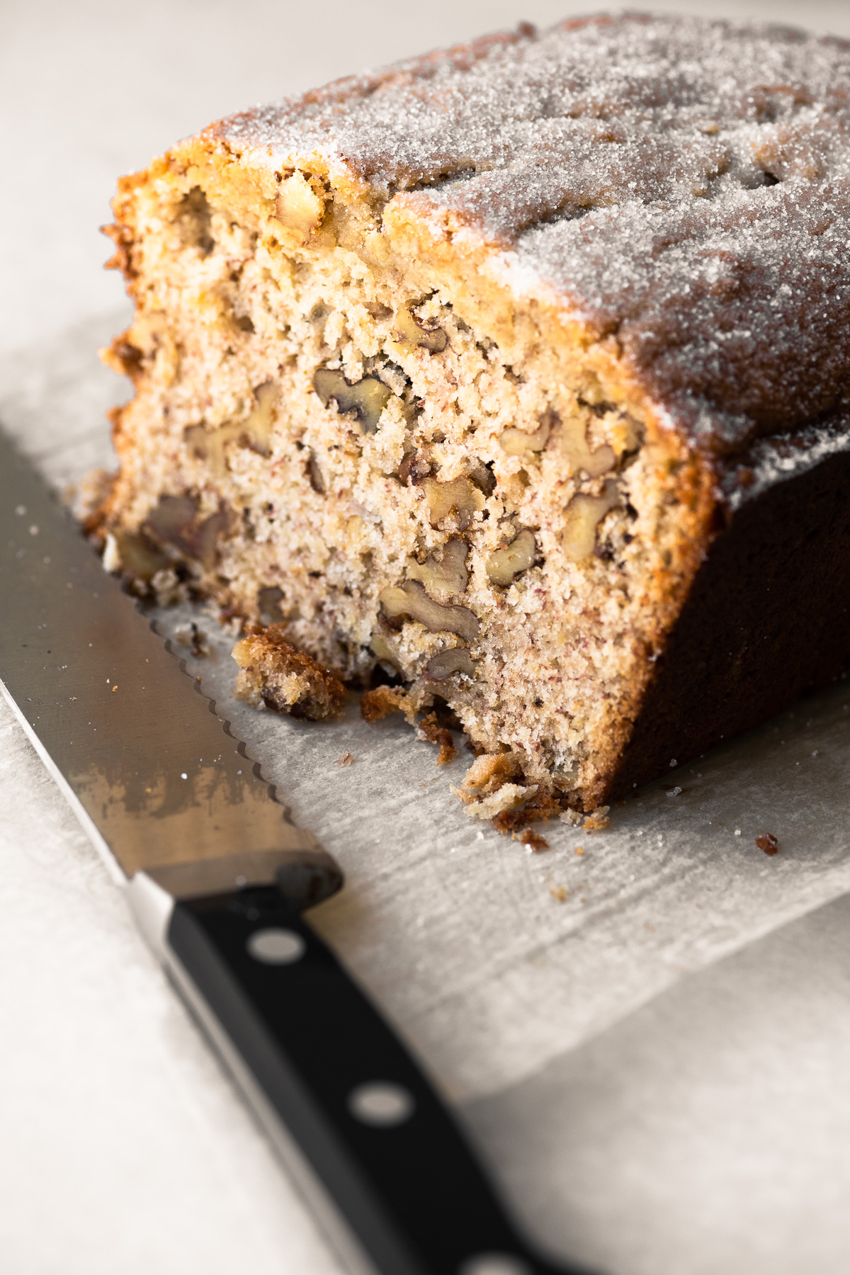 Roasted Banana Bread with serrated knife