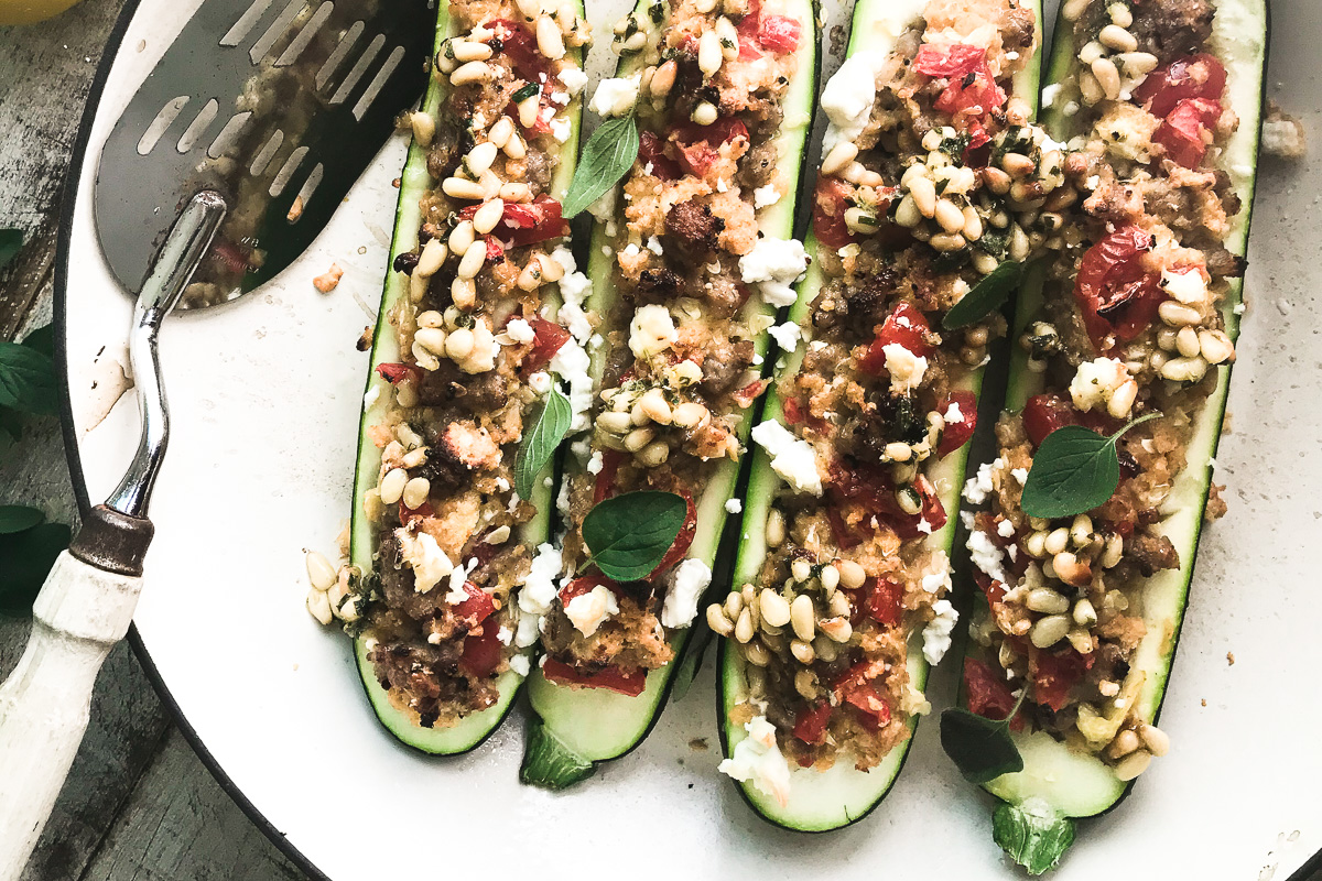 Stuffed zucchini in a pan with spatula