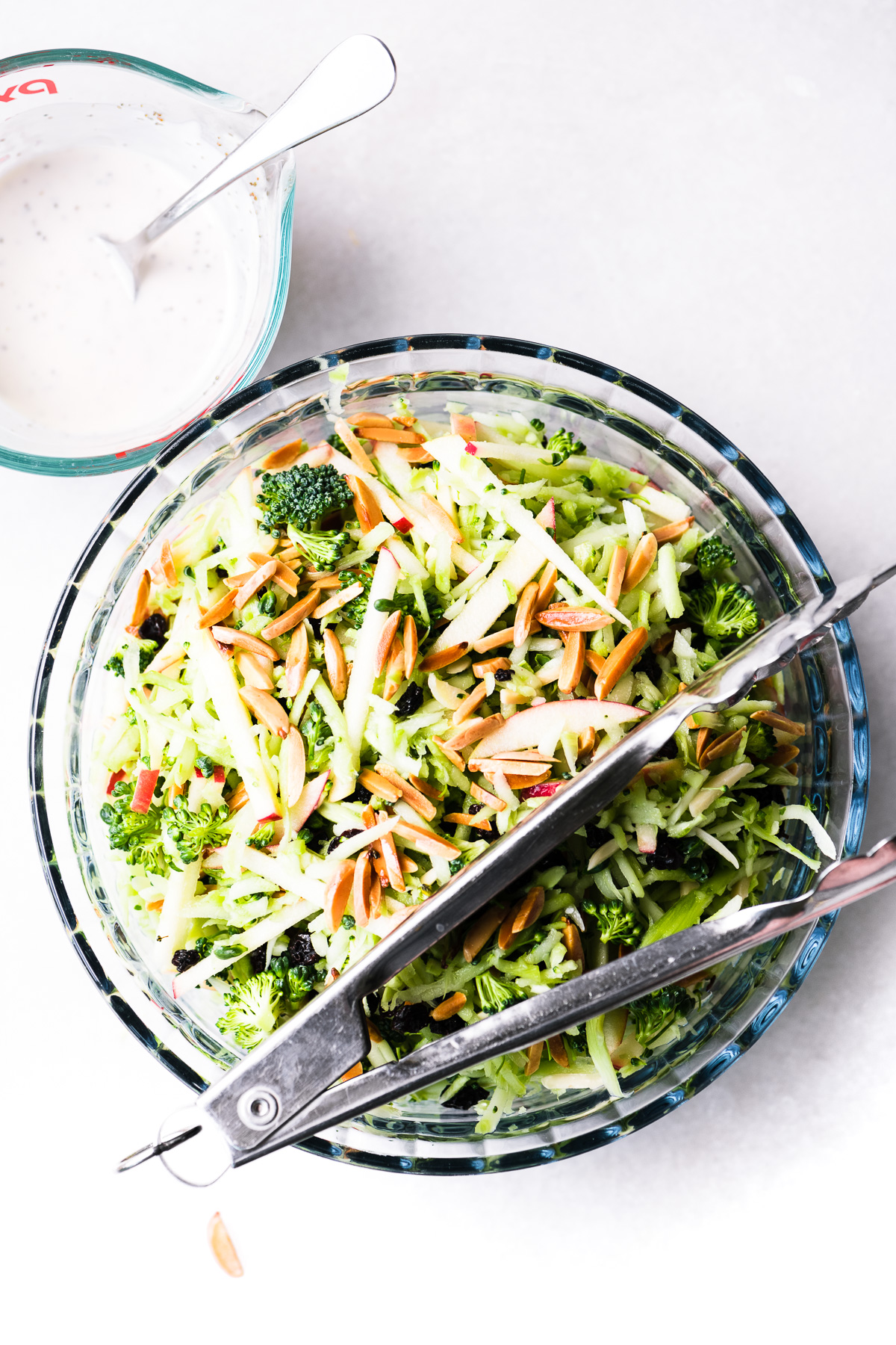 Broccoli Honeycrisp Slaw in a bowl with tongs