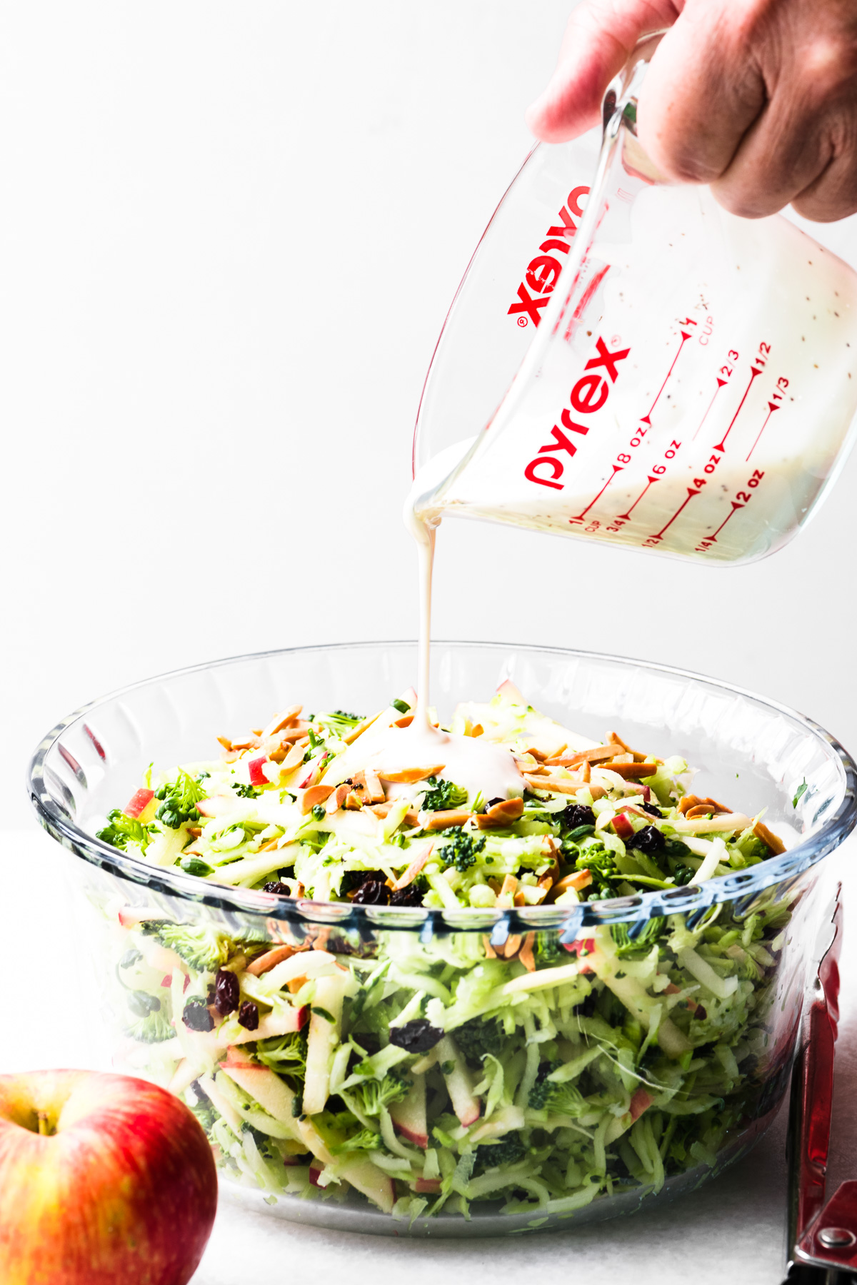 dressing a broccoli honeycrisp slaw salad