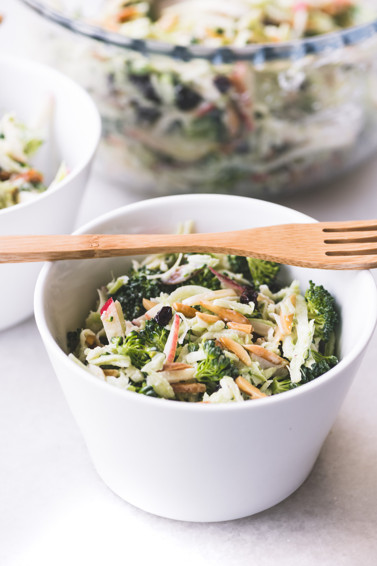 Broccoli Honeycrisp Slaw in white bowls