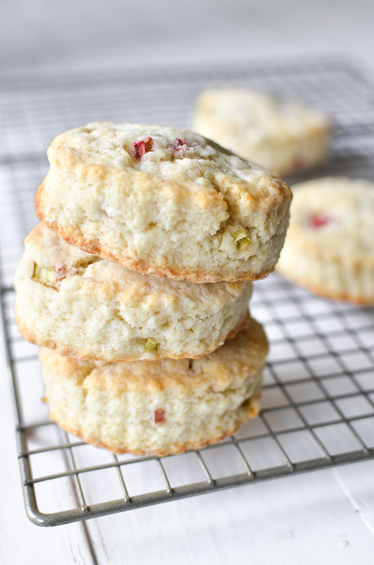 A stack of rhubarb scones on a baking rack