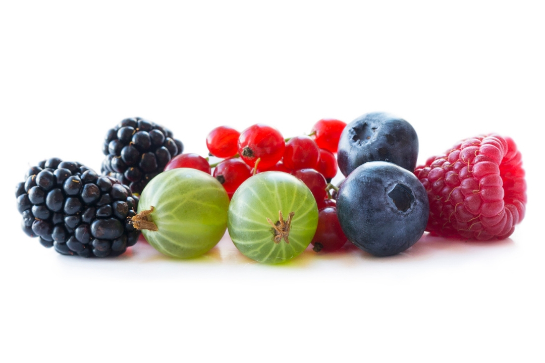 mixed berries on a white surface