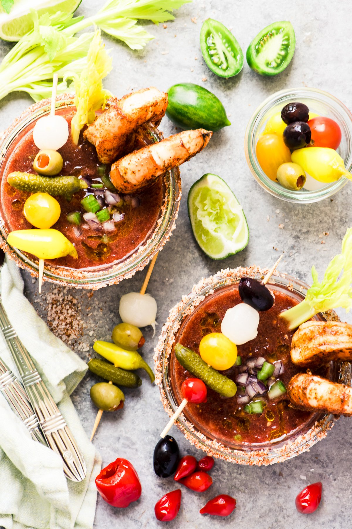 Bloody Mary Gazpacho in small glasses with colorful garnishes
