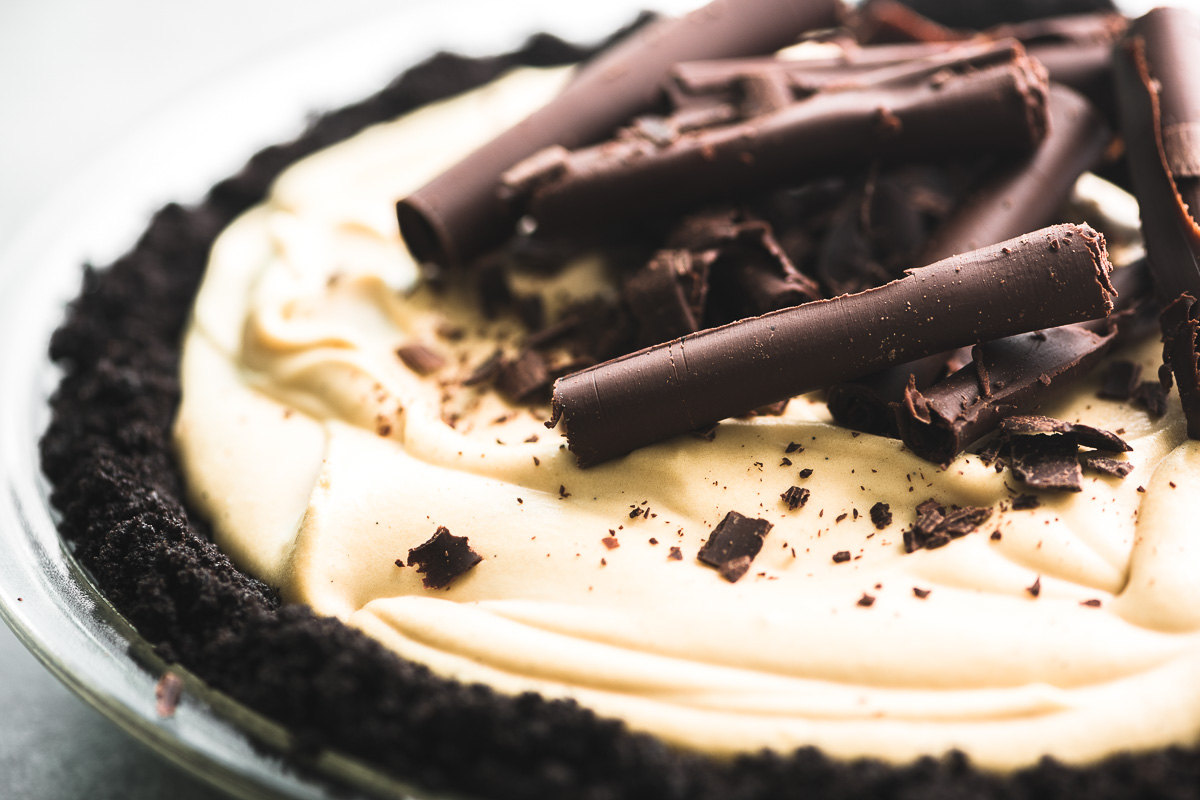 A Brown Sugar Bourbon Icebox Pie topped with shaved chocolate curls