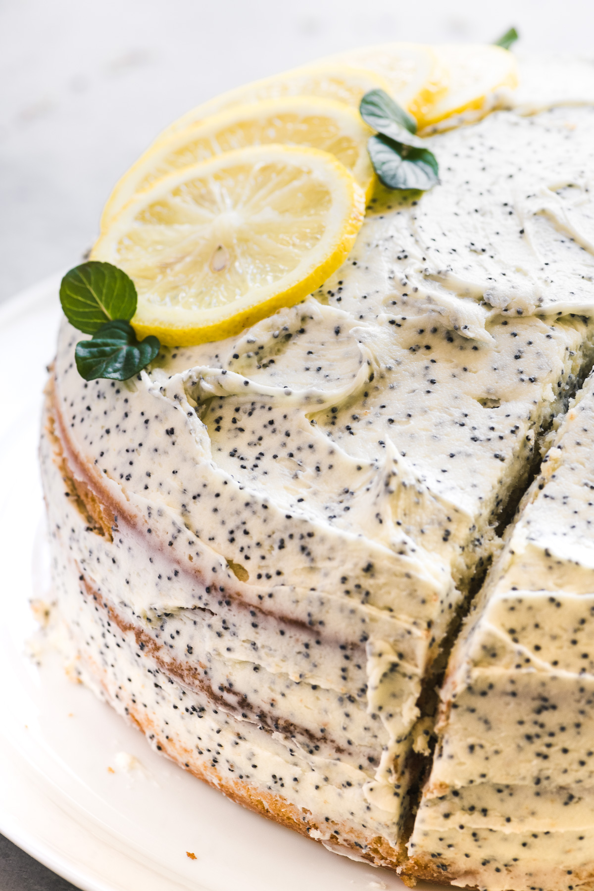 a lemon cake with poppy seed frosting
