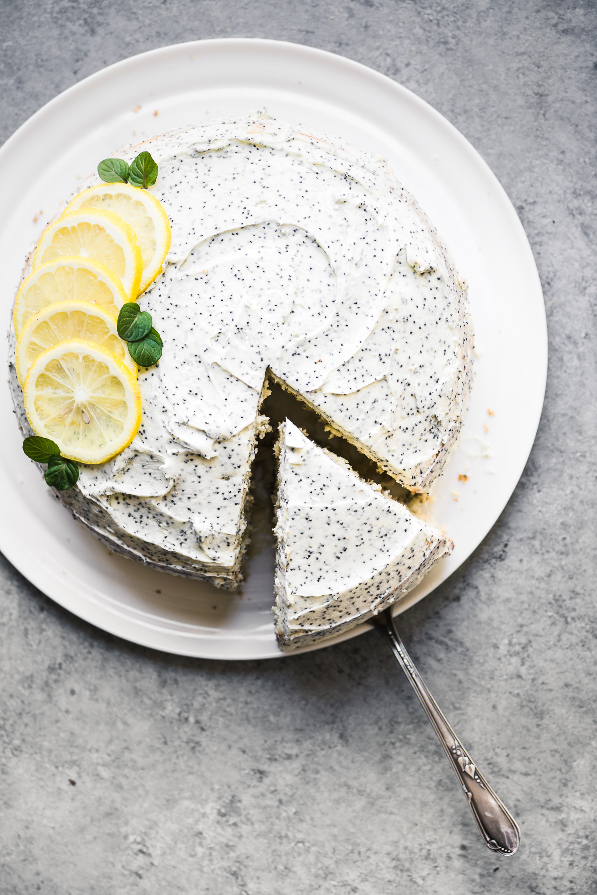 a 3 layer lemon cake with lemon poppy seed frosting