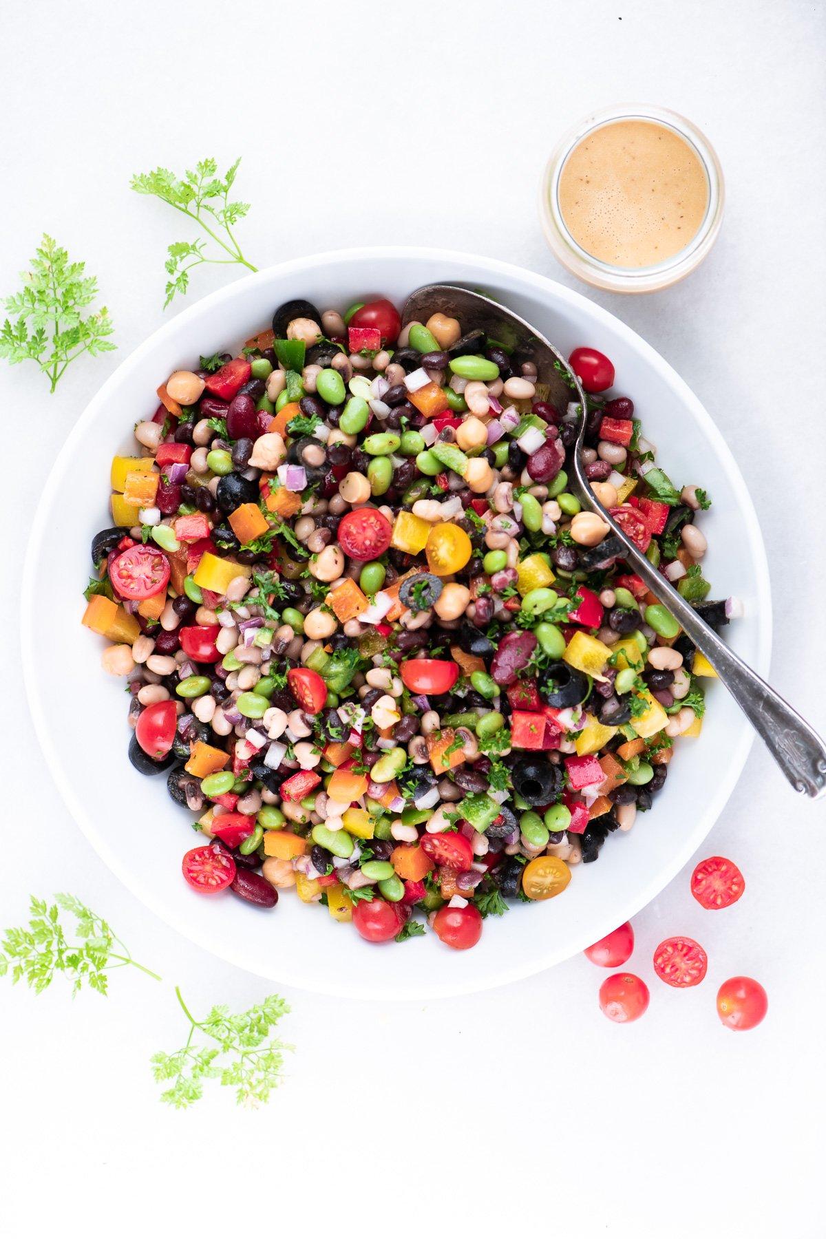 Rainbow Bean Salad in a white bowl